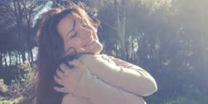 hugging bwoman